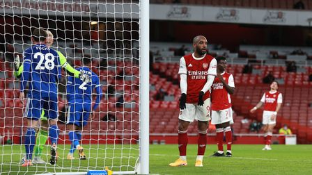 Arsenal's Alexandre Lacazette (centre right) reacts after missing a chance to score