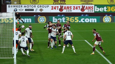 Burnley's James Tarkowski sees his header cleared off the line by Tottenham Hotspur's Harry Kane (le