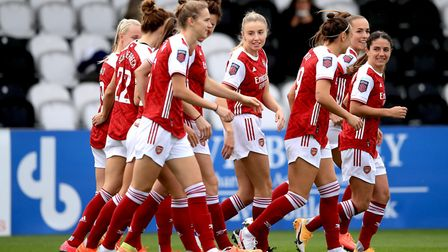 Arsenal players celebrate after teammate Katie McCabe scores their sides first goal of the game duri