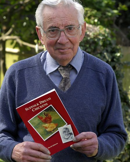 David Johnson with his book about his father farming in Suffolk. The book raised money for research