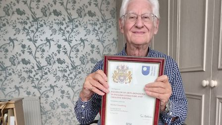 Martin Greenberg with his certificate from the Open University. Picture: Rosalind Greenberg