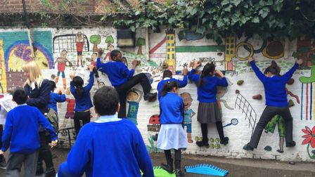 Children from Carlton Primary School play outside after helping to design a new 'active space' for t