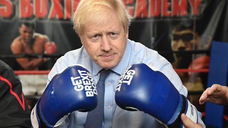 Boris Johnson in 'get Brexit done' gloves