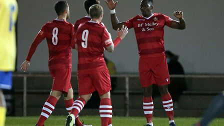 Chris Dickson of Hornchurch scores the second goal for his team and celebrates with his team mates d