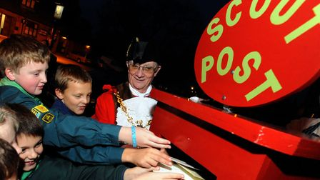 An archive image of children in Ipswich preparing for the 2011 Ipswich Scouts Christmas post. The se