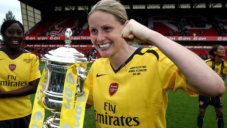 Arsenal's Kelly Smith celebrates with the FA Cup trophy.