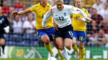 England's Kelly Smith (right) battles with Sweden's Caroline Seger