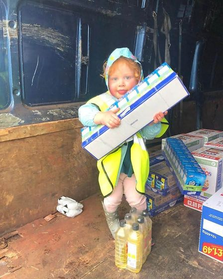 Young volunteer helps Mutail Aid Food Willesden. Picture: Willesden Green Town Team
