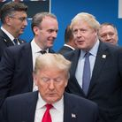 US President Donald Trump (front) with Dominic Raab (centre left) and Boris Johnson (centre right) a
