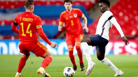 Wales' Connor Roberts (left) and England's Bukayo Saka battle for the ball during the international