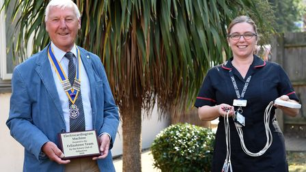 Dougie Pipe, president of the Rotary Club of Felixstowe, presents Renee Ward, Nurse Consultant. wi