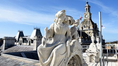 Statues have been restored and replaced on the roof of the Old Post Office in Ipswich. Picture: CHARLOTTE BOND