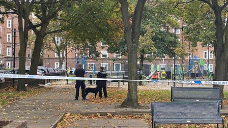 Police have taped off a crime scene outside Nisbet House after three men were shot last night. Picture: @999London