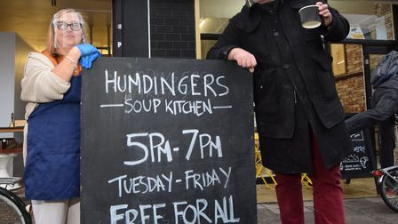 Robert Hunningher and soup kitchen volunteer Barbara Welch, outside Humdingers bakery, soup kitchen and shop at 238 Hoxton...