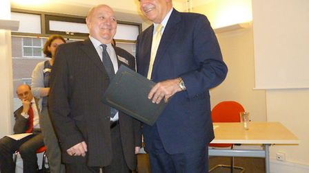 Roy Macdonald (left) receives his award from the president of London Youth, Lord Charles Guthrie