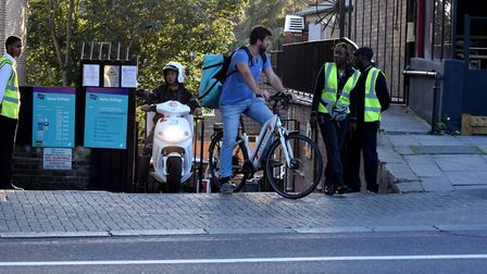 Cyclists look to enter the Finchley Road in Swiss Cottage from the Deliveroo Kitchen. Picture: Polly Hancock