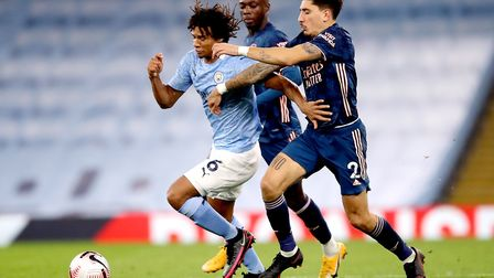 Manchester City's Nathan Ake (left) and Arsenal's Hector Bellerin battle for the ball during the Pre