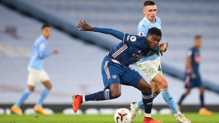 Arsenal's Thomas Partey (left) and Manchester City's Phil Foden battle for the ball during the Premi