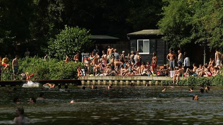 Swimmers and sunbathers enjoying the hot weather in the mixed bathing ponds of Hampstead Heath. Picture: Yui Mok/PA Images