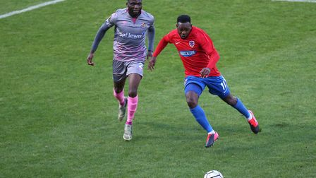 Myles Weston of Dagenham and Redbridge and Michee Efete of Wealdstone during Dagenham & Redbridge vs