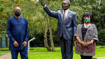 Cllr Joseph Ejiofor with Thembi Tambo in front of her father Oliver Tambo's Muswell Hill statue. The
