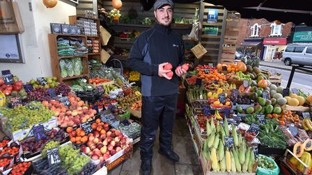 Charlie from Handscomb of Hampstead's fruit and veg stall. Picture: Polly Hancock