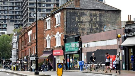 """A faded """"ghost sign"""" for the London North East Railway above the shops opposite Hampstead Heath Over"""