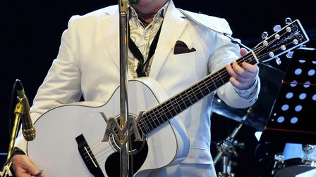 Van Morrison performs on stage to perform at Vince Power's Hop Farm Festival in Kent.