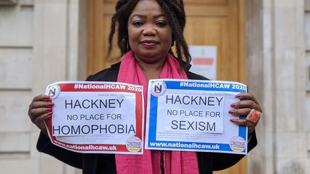 Cllr Fajana Thomas holds up signs saying Hackney is no place for homophobia and sexism. Picture: Hac