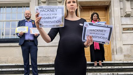 Cllr Selman raising awareness by holding up signs which read: 'Hackney, no place for disability disc