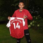Arsenal's Pierre-Emerick Aubameyang with the shirt he is donating to the Museum of London. Picture: