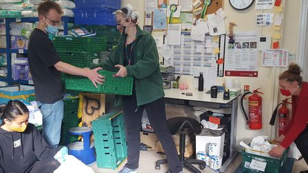 Staff and volunteers working at Hackney Foodbank's warehouse at the Florence Bennett Centre in Hoxto