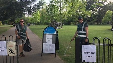 Volunteers help tidy West Ham Park, which has kept its Green Flag Award status. Picture: City of Lon