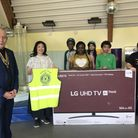 Newham Rotary Club donated a TV to AAA. Picture: AAA