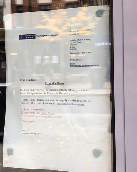 A letter from the Met Police is stuck to the door of Equitable House, asking witnesses to come forwa