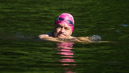 A swimmer in the Hampstead Heath mixed bathing pond in July. Picture: Aaron Chown/PA