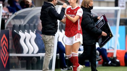 Arsenal's Vivianne Miedema (right) speaks to manager Joe Montemurro as she is substituted during the