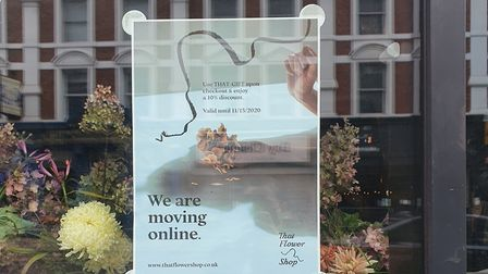 A sign outside That Flower Shop's former premises in Shoreditch advertising its online shop. Picture