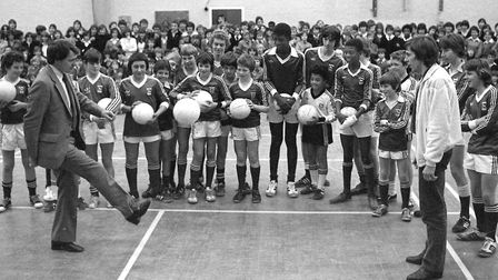 Bobby Robson and Arnold Muhren demonstrating their skills to youngsters at Westbourne School in Ipsw
