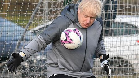 Prime minister Boris Johnson plays football during the election campaign. Photograph: Stefan Roussea