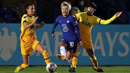 Chelsea's Ji So-Yun (centre) battles for the ball with Tottenham Hotspur's Rosella Ayane (left) and
