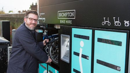 Councillor James Asser at the Brompton bike hire dock by Maryland station. Picture: Andrew Baker