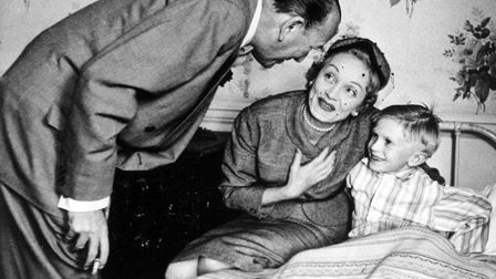 BY0DHG NOEL COWARD with Marlene Dietrich with Jonathan Morris on a visit to the Actors' Orphanage at