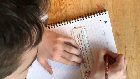 A child uses some of Handy Spelling's dyslexia-aids - pencils and rulers! Picture: Handy Spelling