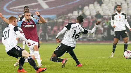 West Ham United's Tomas Soucek (centre) scores his side's first goal of the game during the Premier