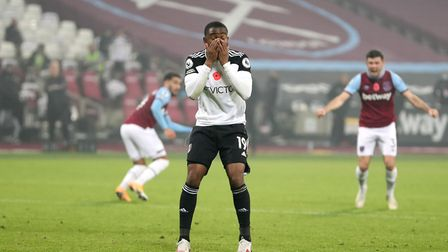 Fulham's Ademola Lookman reacts after seeing his penalty saved during the Premier League match at th