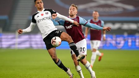 Fulham's Antonee Robinson (left) and West Ham United's Jarrod Bowen battle for the ball during the P