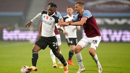 Fulham's Andre-Frank Zambo Anguissa (left) and West Ham United's Tomas Soucek battle for the ball du