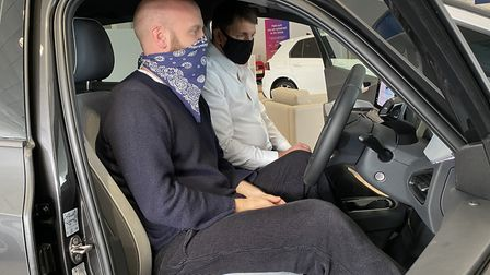 Coldplay drummer Will Champion at Alan Day Volkswagen, in West Hampstead, where he bought a new Volk