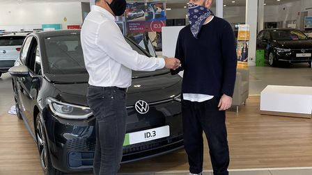 Will Champion buys a Volkswagen ID3 from Paul Tanner at Alan Day Volkswagen in West Hampstead. Pictu